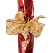 Fragment of festive packing with golden ribbon — Stock Photo