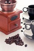 Koffiekopje met koffiemolen — Stockfoto