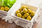 Olives are in two white bowls with leaves — Stock Photo