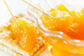 Peeled tangerine slices on a cookie — Stock Photo