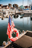 Yacht with American flag At The Pier — Stockfoto