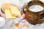 Cottage white cheese in a bowl , eggs  and pastry — Stock Photo