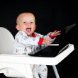 Baby with the laptop - Stock Photo