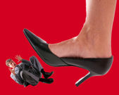 Man under woman heels — Stock Photo