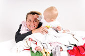 Mother and her son doing laundry — Stock Photo