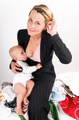 Happy mother breastfeeding her son — Stock Photo