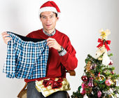 Man unwrapping a Christmas gift — Stock Photo