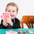 Boy playing poker — Stock Photo