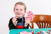 Boy playing poker — Stock Photo