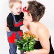 Stock Photo: Womwith flower and her son