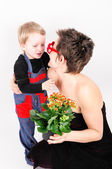 Woman with a flower and her son — Stock Photo