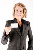 Business woman with a card — Stock Photo