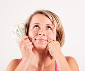 Young woman with money in hand — Stock Photo