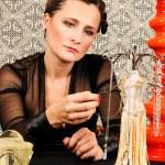Woman chooses jewelery — Stock Photo