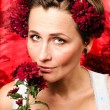 Stock Photo: Womholding flower