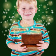Stock Photo: Boy with box full of miracles