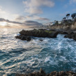 Sunset over rocky southern Californian coast - Stock Photo