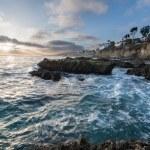 Sunset over rocky southern Californian coast — Stock Photo #14065878