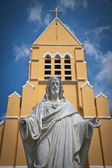 Statue of Jesus Christ and Church — Stock Photo