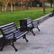 Stock Photo: Brown benches with nobody in park