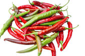 Red and green chili peppers on white background — Stock Photo