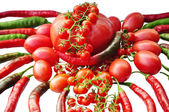 Tomatoes and red hot chili peppers, isolated on white backgroun — Foto de Stock