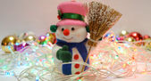 Snowman with garland — Stock Photo
