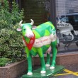 Green cow. Toy near the shop. — Stock Photo