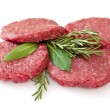 Stock Photo: Raw hamburgers isolated on white background