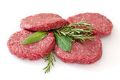 Raw hamburgers isolated on white background — Stockfoto