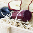 Stock Photo: Bottle of old red wine in gift wooden box