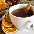 Stock Photo: Cup of orange tewith cinnamon