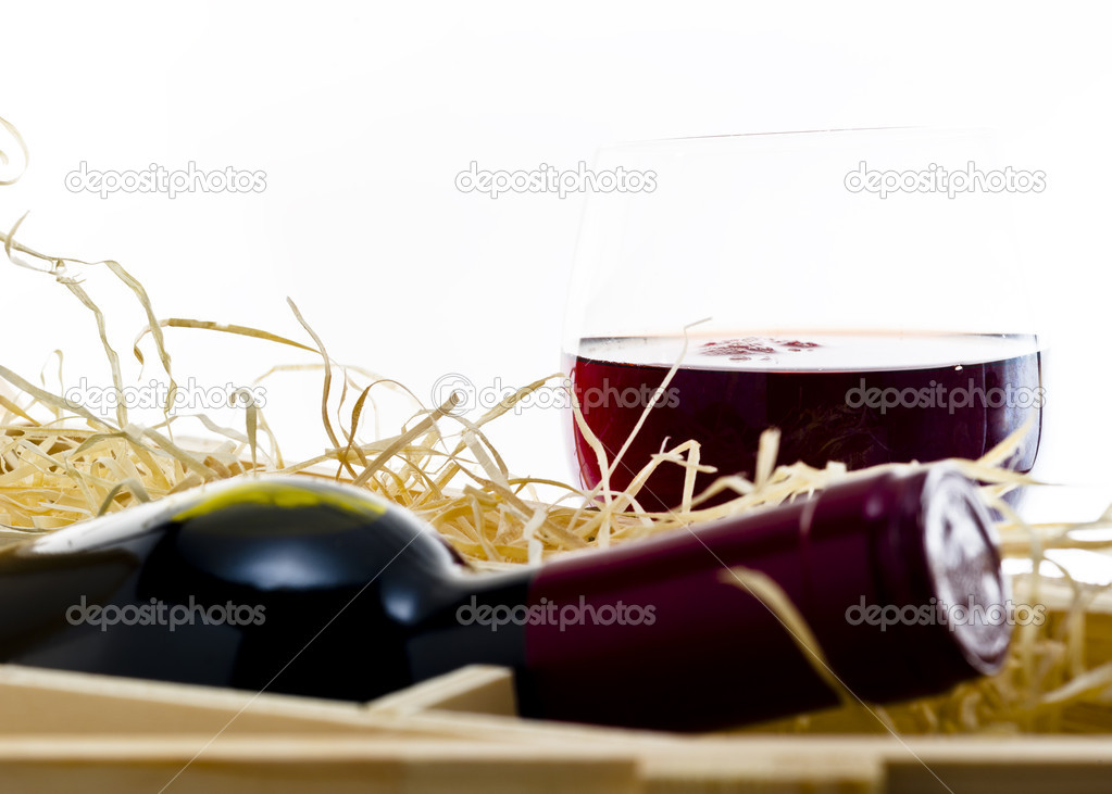 Bottle of old red wine in gift wooden box  Stock Photo #18746333