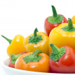 Mixed peppers in white plate — Stockfoto