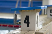 Swimming pool starting block — Stock Photo