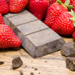 Stock Photo: Strawberries raw chocolate on whooden table