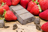 Strawberries raw chocolate on whooden table — Stockfoto