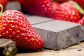 Strawberries raw chocolate on whooden table — Stock Photo