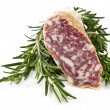 Slices of salame and rosemary - Foto de Stock