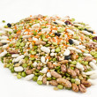 Dried legumes and cereals on a white background — Stock Photo
