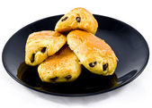 Fresh and tasty buns with raisins — Stock Photo