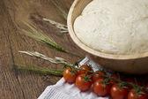 Homemade Dough on wooden table — Stock Photo