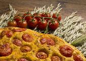 Apulian Focaccia with tomatoes — Stock Photo