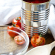 Stock Photo: Canned raw food and tomatoes