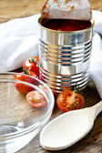 Canned raw food and tomatoes — Stock Photo