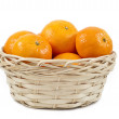Tangerines (mandarin)  in a straw cup — Stock Photo