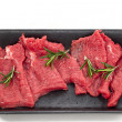 Supermarket packaged porterhouse steaks in white background — ストック写真