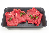 Supermarket packaged porterhouse steaks in white background — Stock Photo