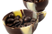 Coffee beans in a chocolate cups — Stock Photo