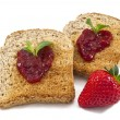 Stock Photo: Sweet strawberries jam on toast close up